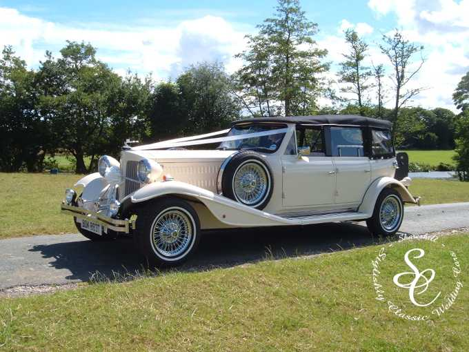 Beauford wedding car on the drive to Somerford Hall