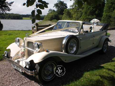 Beauford wedding car at the lakeside in the grounds of Chillington Hall.