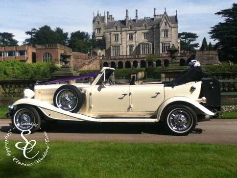 Beauford wedding car in the gardens of Lilleshall Hall.