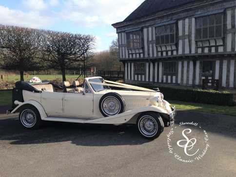Beauford wedding car at Middleton Hall with the timber framed building in the background.