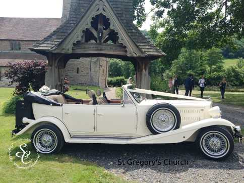 Beauford wedding car outside the main gate to St Gregory's Church in Moreville.