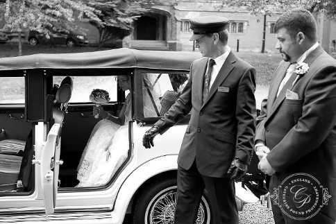 Groom awaiting his Bride to exit the car at Hawkesyard Hall.