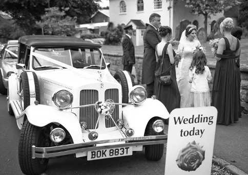 Bride standing near to the Beauford after her arrival at Wombourne.